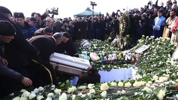 Six-month-old Seryozha Avetisian is buried in Gyumri. Jan 21, 2015. (Photo: Photolur)