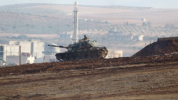 A Turkish tank takes position near Esme in Syrian Kurdistan, where the tomb of Suleyman Shah has been relocated. (Photo: Reuters)