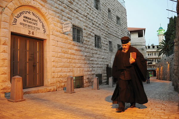 A priest walks through one of the street's in Jerusalem's Armenian Quarter. (Photo: Matthew Karanian)