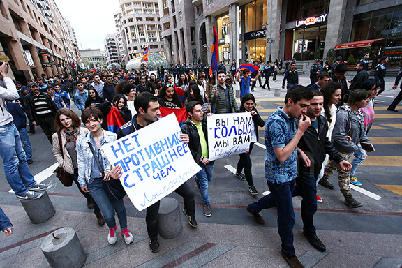 Protesters marched to the Russian Embassy in Yerevan to demand an end to Moscow's arms sales to Baku