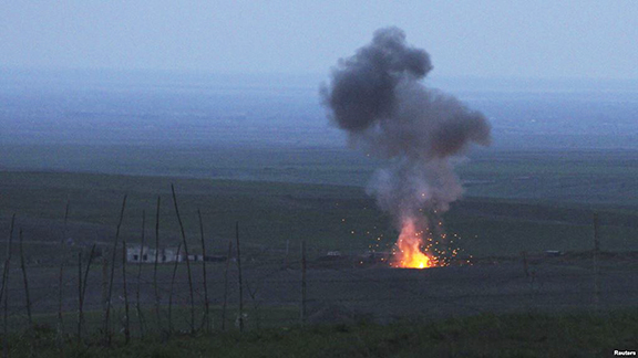 Smoke from fire rises above the ground in Martakert district, after an Azerbaijani unmanned military air vehicle was shot down by the self-defense army of Nagorno-Karabakh (Reuters Photo)
