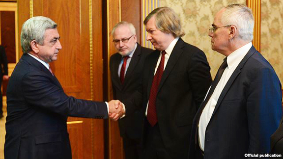 President Serzh Sarkisian (L) meets with the U.S., Russian and French co-chairs of the OSCE Minsk Group in Yerevan on April 9