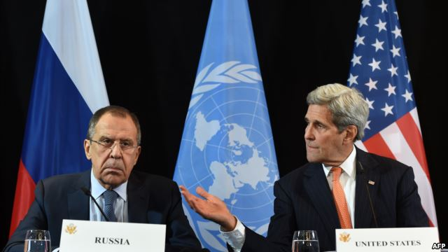 GERMANY -- US Secretary of State John Kerry (R) gestures beside of Russian Foreign Minister Sergei Lavrov (L) during a news conference after the International Syria Support Group (ISSG) meeting in Munich on February 12, 2016. / AFP / Christof STACHE