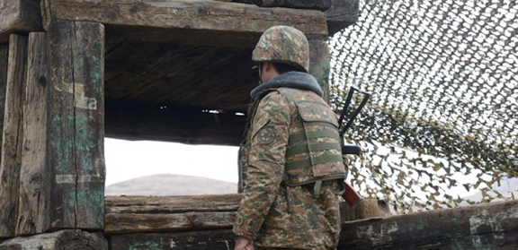 Artsakh serviceman observing frontline (Source: ArmRadio)