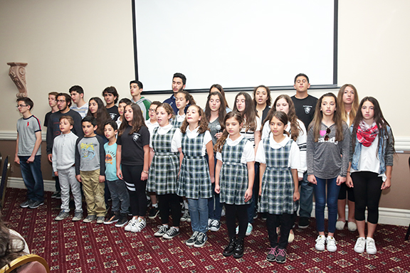 """Students from the Ari Guiragos Minassian school joined the AYF """"Aghpiur Serop"""" Juniors  in a performance during the event"""