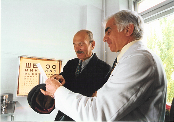 AECP Founder Dr. Roger Ohanesian with patient during past Medical Mission to Armenia.