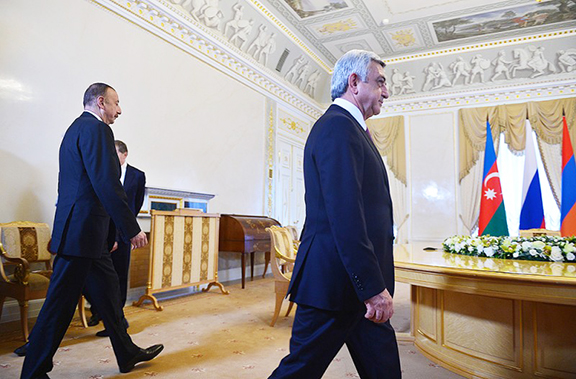 President Serzh Sarkisian (foreground) and his Azerbaijani counterpart Ilham Aliyev walk into a meeting in St. Petersburg on Monday (Official Photo)
