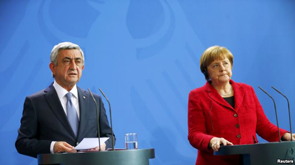 Armenian President Serzh Sarkisian and German Chancellor Angela Merkel address a news conference after talks at the Chancellery in Berlin. (Photo: Reuters)