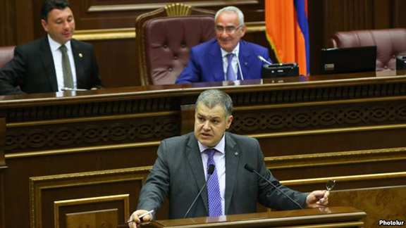 Davit Harutiunian, the chief of the Armenian government staff, speaks during a parliamentary debate in Yerevan on the Electoral Code on June 27. (Photo: Photolur)
