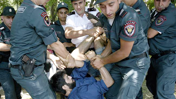 Armenian police drag a protester before arresting him on Monday in Yerevan