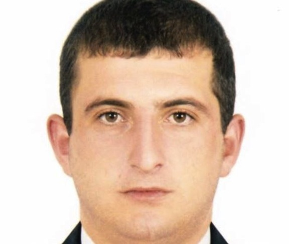 Police officer Yuri Tepanosyan was killed within the seized police compound