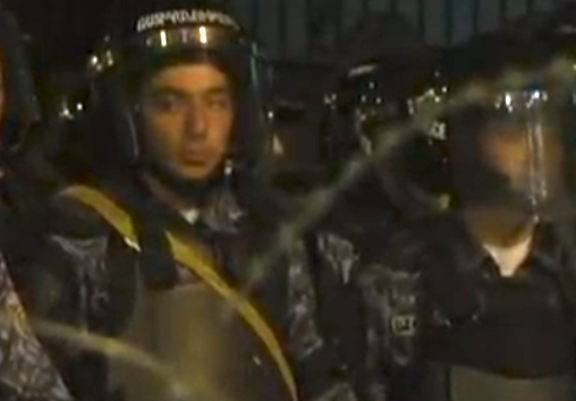 Police form barricade behind barbed wire on Baghramyan Street on Saturday