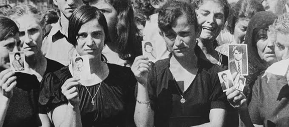 Cypriots hold up photos of missing family members following Turkey's 1974 invasion. Over 5,000 Cypriots were killed while hundreds of thousands of refugees were ethnically cleansed and forced into concentration camps. Excavations and DNA testing continue to this day to locate the thousands that are missing and to bring closure to their families.