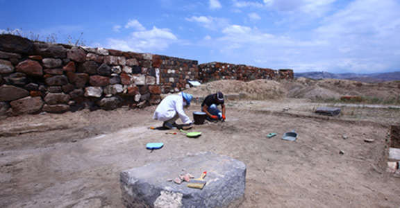 A team of  archaeologists works on the excavation of the 2,700-year-old street