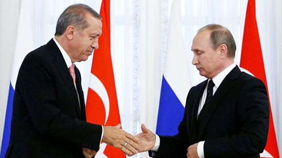 Turkish President Recep Tayyip Erdogan (left) meets with President Vladimir Putin on Tuesday in St. Petersburg
