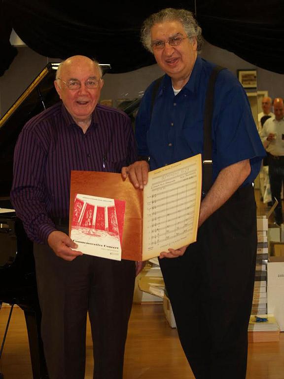 Mr. Karabian donates the original manuscript of Alan Hovhannes' Symphony No. 28 to Lark. (Walter Karabian and Vatsche Barsoumian)