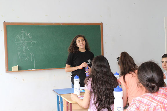 AYF Youth Corps 2016 participant, Talar Behesnilian, in classroom with campers in Artik, Shirak Marz, Armenia.