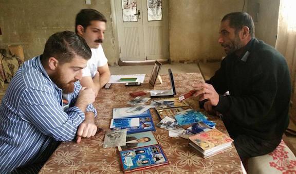 Dickran Khodanian (left) with his colleague Khatchig Joukadjian (far left) visit the the family of Armen Martirosyan, a fallen soldier