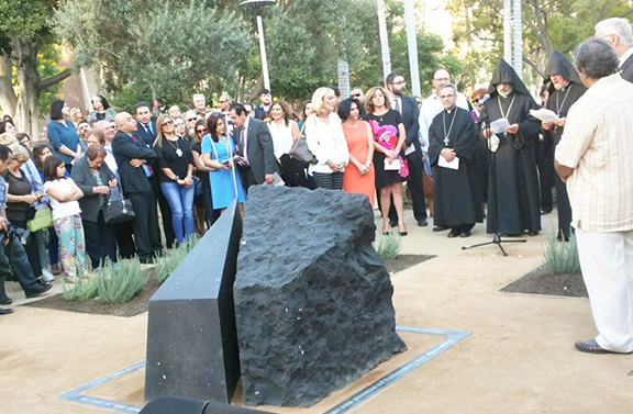 Clergy and organizers gather after the unveiling of the Armenian Genocide Monument at Grand Park in Los Angeles