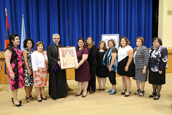 Western Prelate Archbishop Moushegh Mardirossian presenting a certificate of commendation to the ARS Western Regional Executive
