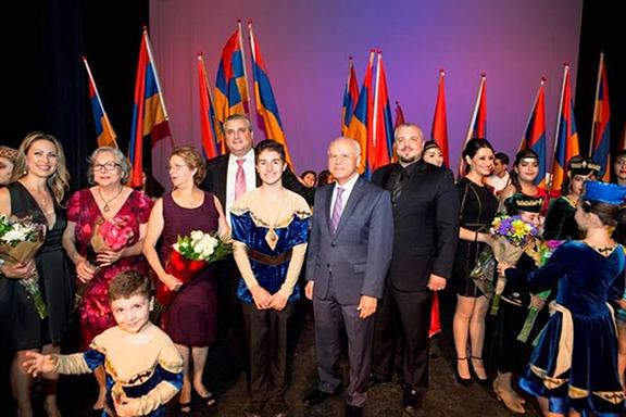 Ambassador Hovhannissian onstage congratulating the celebration organizers
