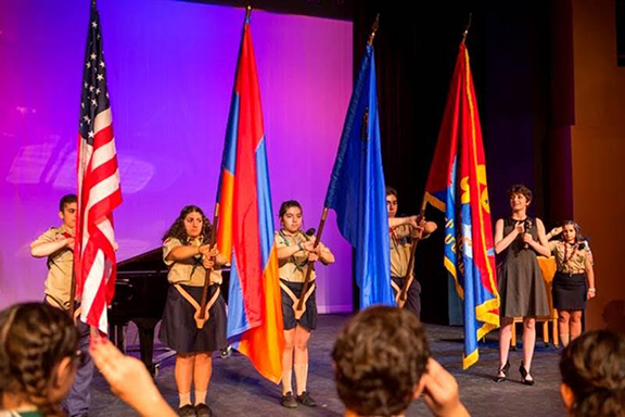 Flag Presentation by Homenetmen Scouts and Naree Asherian singing National Anthems