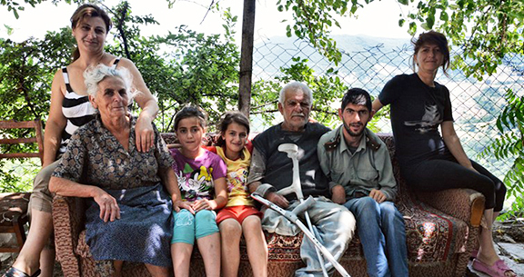 The Merjumian family who live next to a minefield in the village of Myurishen. (Photo: The Halo Trust)