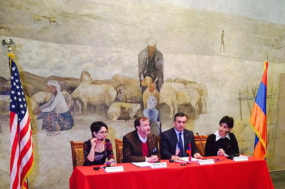 U.S. Ambassador to Armenia Richard Mills' (second from left) Fund for Cultural Preservation funded the restoration of the mural shown in back (Photo: U.S. Embassy Yerevan Facebook Page)
