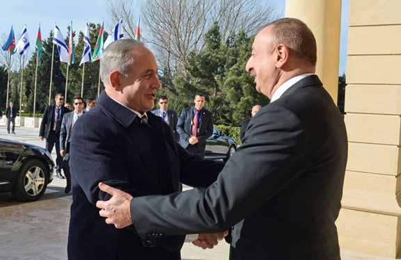 Azerbaijani President Ilham Aliyev (right) greets Israeli Prime Minister Benjamin Netanyahu in Baku on Dec. 13