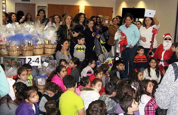 Children and youth of all ages, gathered to receive toys and gift baskets in celebration of the New Year and Christmas at the ARS Regional Headquarters in Glendale, California.