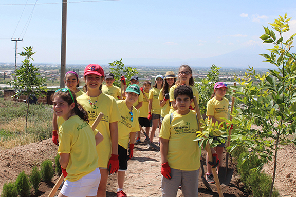 ATP's environmental education program reaches thousands of students every year, even in the diaspora; fifth graders from St. Stephen's Armenian Elementary School in Watertown are pictured here planting trees in Armenia (Photo: Armenia Tree Project)