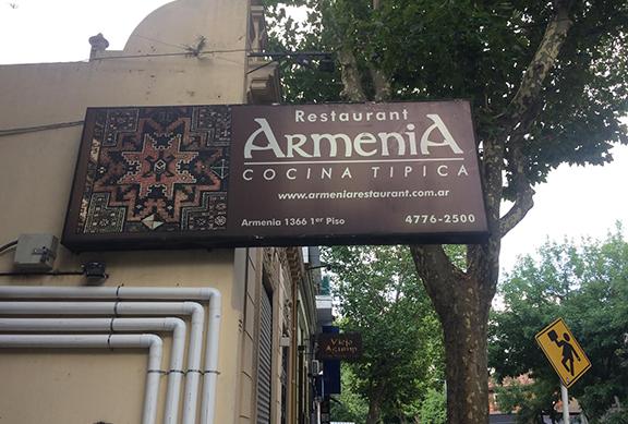 A sign of Armenia restaurant on Armenia street