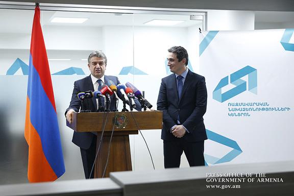 Prime Minister Karen Karapetyan speaks at opening ceremony of GCSI in Yerevan on Jan. 12, 2017, accompanied by the center's Executive Director, Aleksandr Khachaturyan (Photo: gov.am)