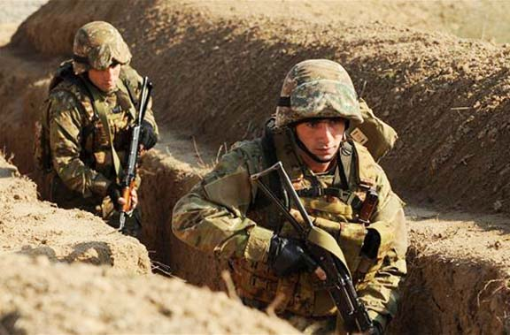 Artsakh soldiers in border trenches