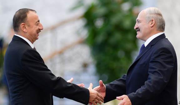 Azeri President Ilham Aliyev greets Belarus President Alexander Lukashenko in 2014
