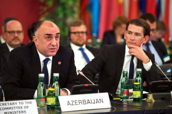 """Azerbaijani Minister for Foreign Affairs Elmar Mammadyarov (left) talks about the priorities his country will have during its six-month chairmanship of the Council of Europe in Vienna on May 6. Amid criticism of his country on liberties issues, Mammadyarov vowed to show """"strong support"""" for human rights by making it one of the pillars of the chairmanship. (Photo: Council of Europe/Sandro Weltin)"""