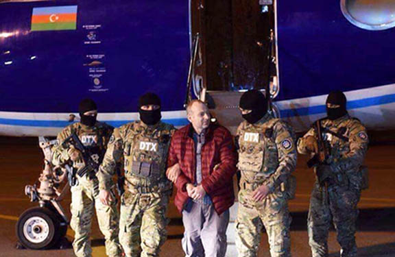 Azerbaijani security forces withAlexander Lapshin at Baku airport