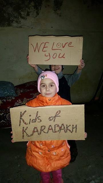 Children holding signs in appreciation of Kids of Karabakh