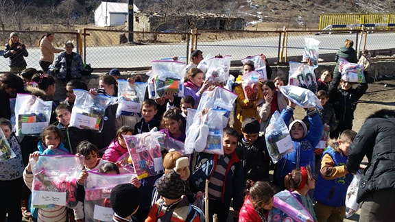 Artsakh kids from a remote village receive 60 pairs of new shoes, socks, toys, dolls, jump ropes, arts and crafts supplies, and puzzles.