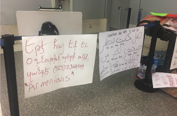 Signs at Los Angeles International Airport offering translation help for newcomer immigrants.