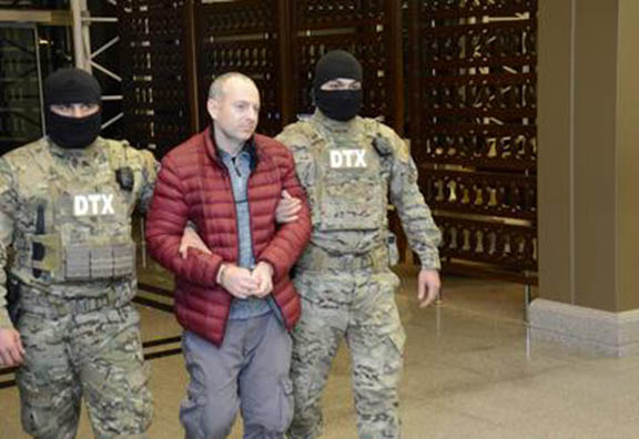 Blogger Aleksandr Lapshin being escorted by Azeri special forces upon his arrival in Baku on February 7