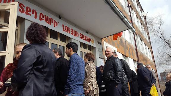 Voter line up at a polling place on Sunday for the Parliamentary Elections (Photo by Razmig Sarkissian)