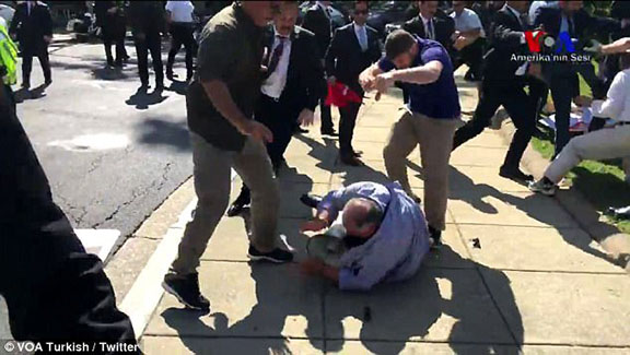 Erdogan supporters beat a protester last week in front of the Turkish Ambassador's residence in DC