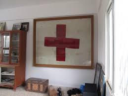 The flag with the red cross displayed at a home in Anjar, Lebanon