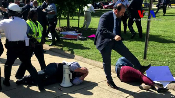 Erdogan's security personnel attack peaceful protesters during demonstration hear the Turkish ambassador's residence in Washington DC on May 16, 2017. (Image: VOA Turkish Video/Screenshot)