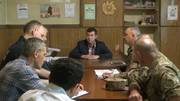 OSCE monitors at a briefing with Armenian Defense Ministry officials