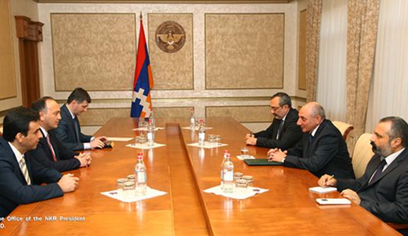 Abkhazia's Foreign Minister Daur Kove (left) meets with Artsakh President Bako Sahakian