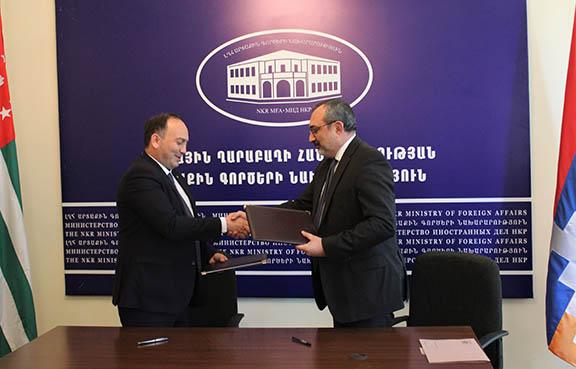 Abkhazia Foreign Minister Daur Kove (left) with his Artsakh counterpart Karen Mirzoyan after signing a memorandum of understanding