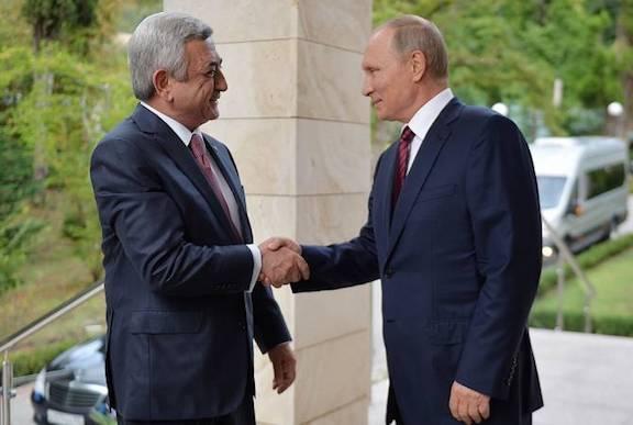 Russian President Vladimir Putin greets Serzh Sarkisian in Sochi on Wednesday