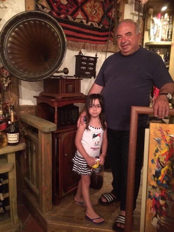 Akhoyan with his granddaughter at his home